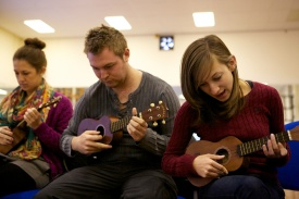 Students learn to play ukuleles